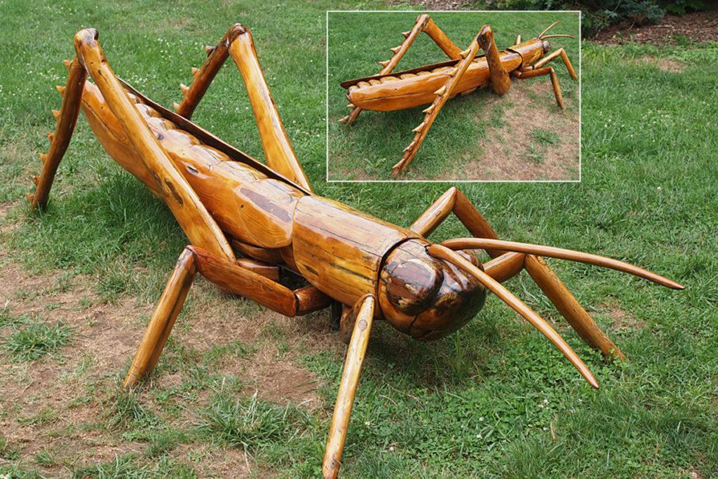 Giant wooden grasshopper sculpture