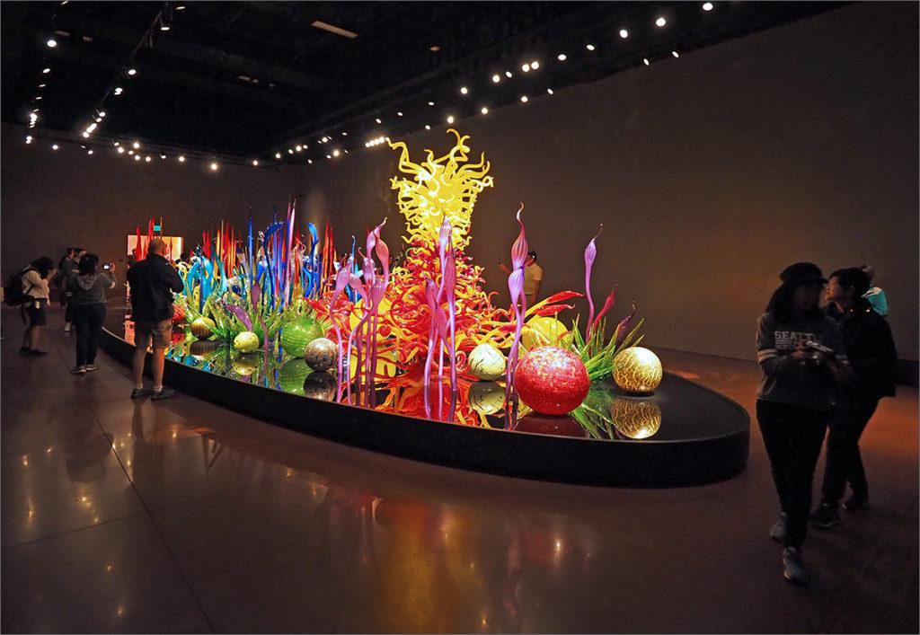 A garden-like display of glass art works.