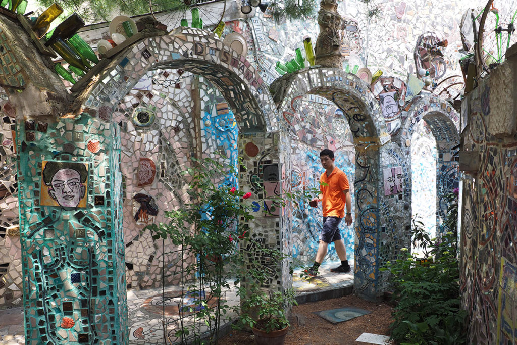Architectural arches in Philadelphia's Magic Garden are covered in pieces of broken mirrow.