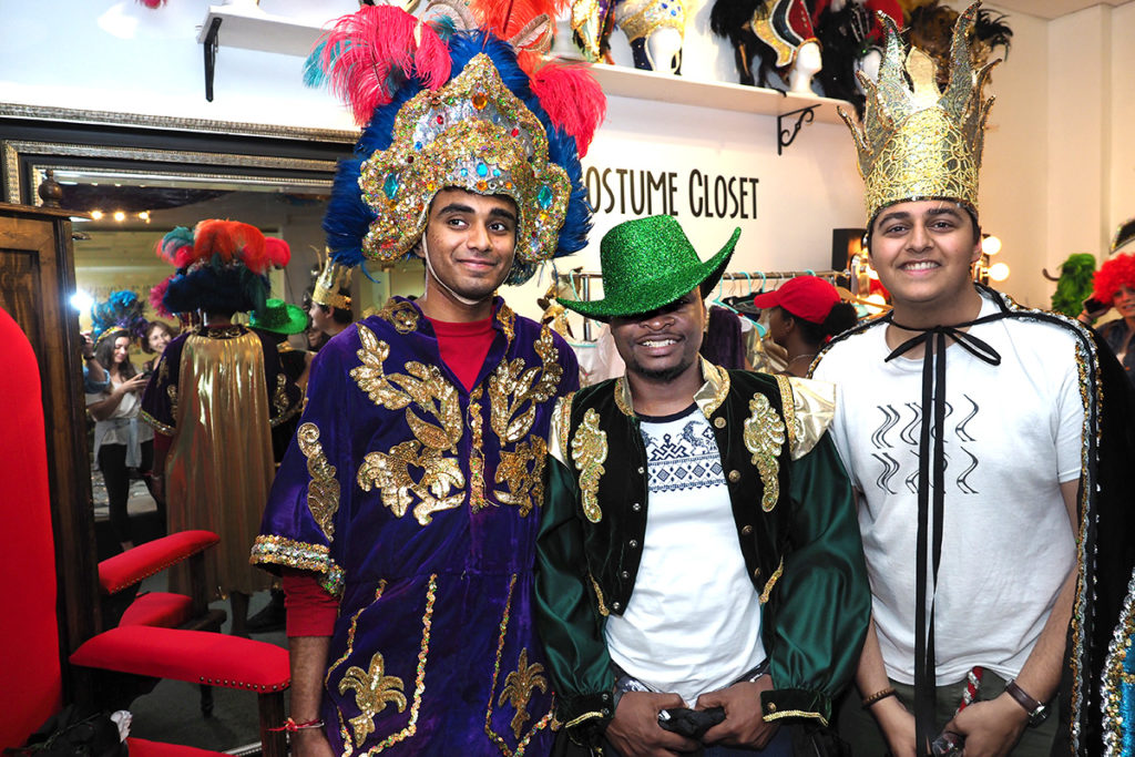 """College student tourists at play in the Mardi Gras Museum """"costume closet"""""""