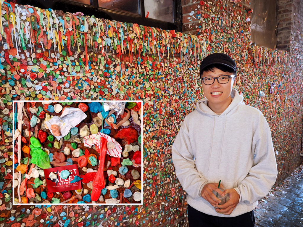 New York tourist explores Seattle's infamous gum wall.