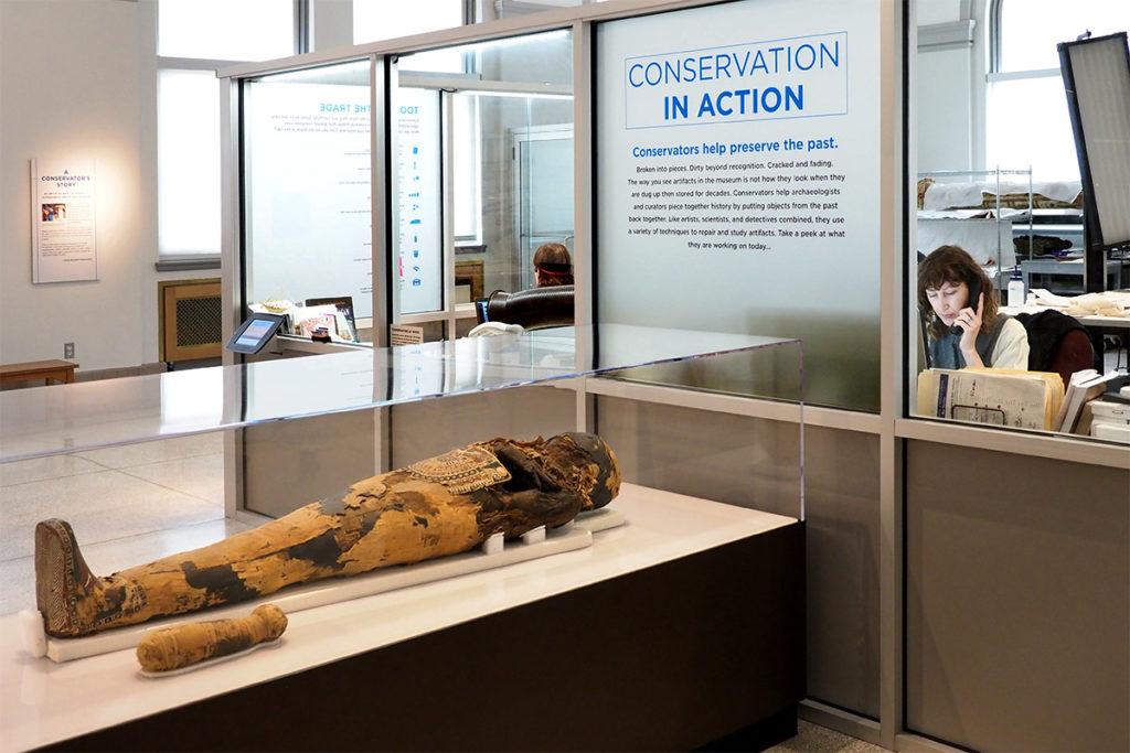 Penn's Artifact Lab staff work amidst mummies.