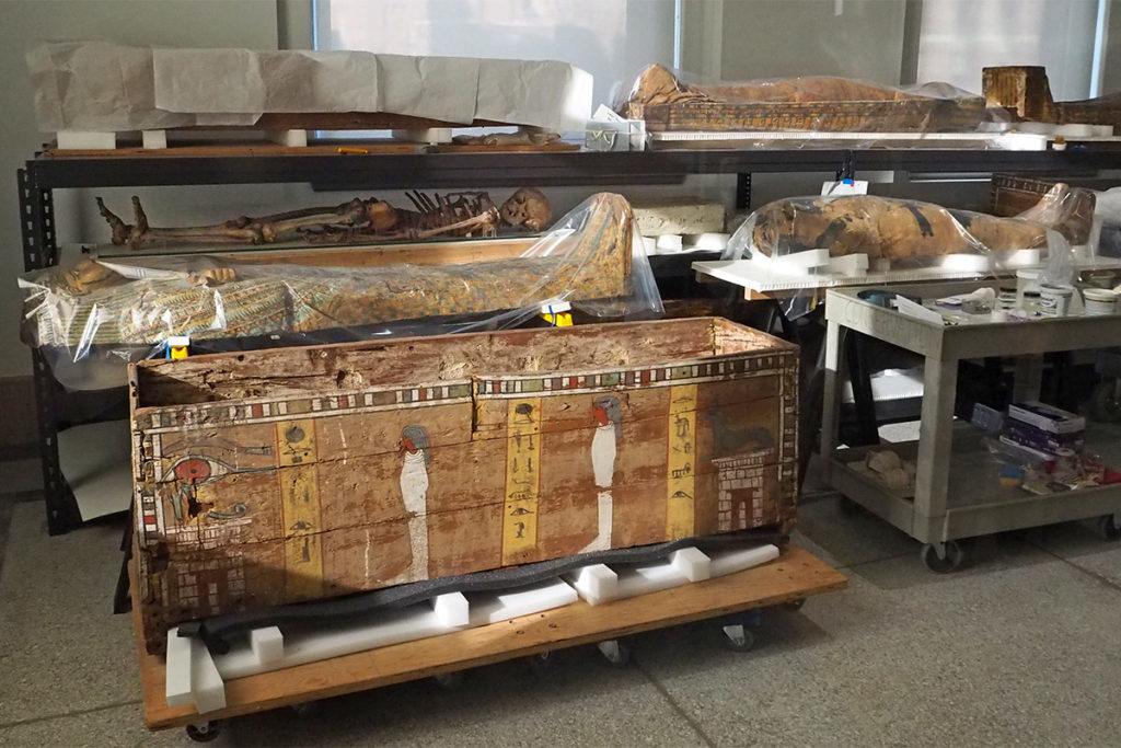 Ancient mummies, skeletons and coffins.