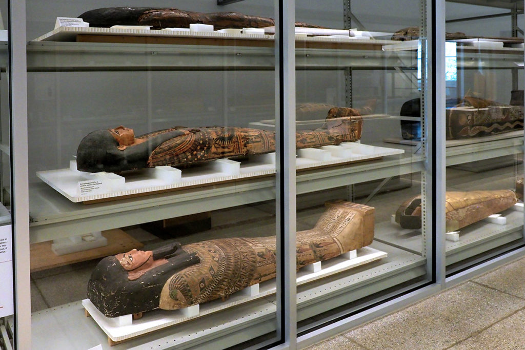 Stacked three high, mummies and their cases line the walls of Penn's Artifact Lab.