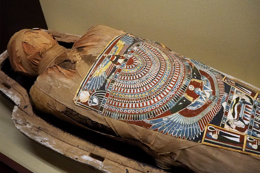 Incredibly detailed and ornate artwork on a mummy chest plate.
