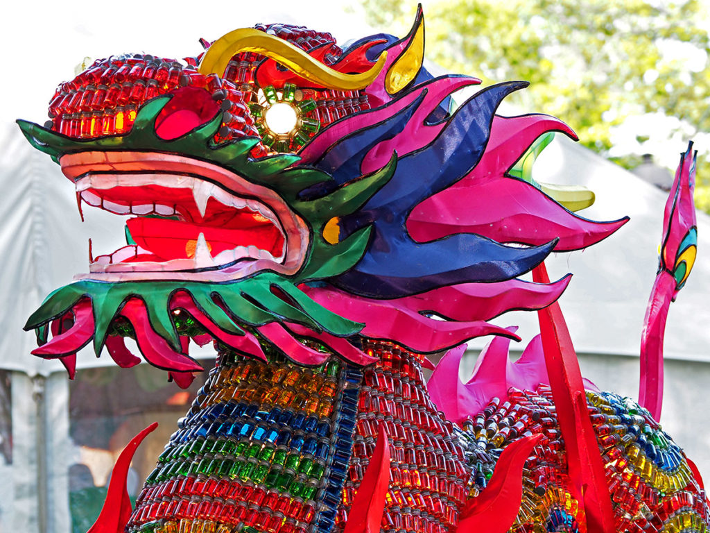 Chinese festival lantern dragon made from hundreds of tiny bottles filled with colored water.