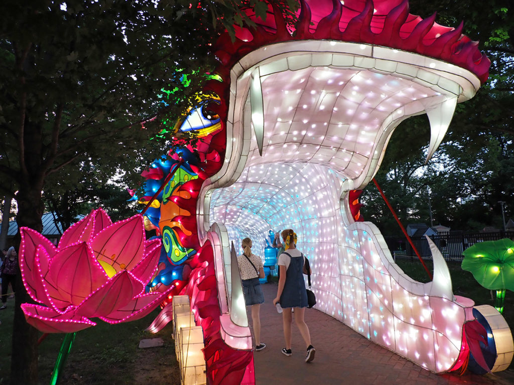 Visitors walk into the mouth of giant dragon at Philadelphia Chinese Lantern Festival