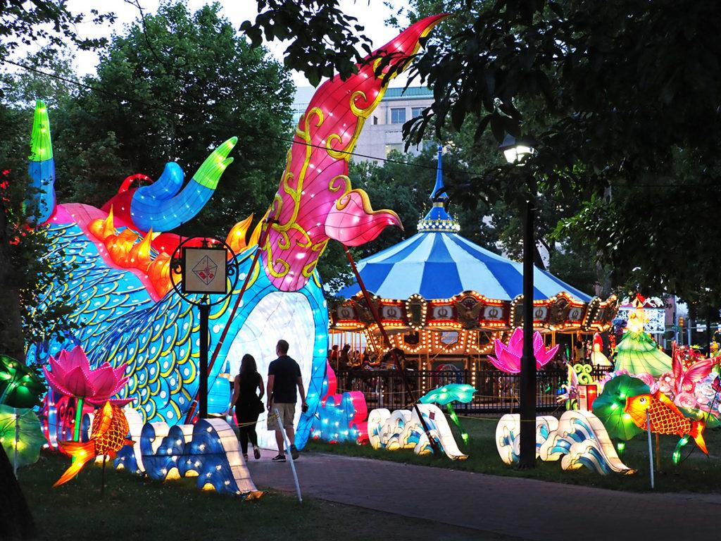 Visitors enter rear end of gigantic dragon figure at Philadelphia Chinese Lantern Festival