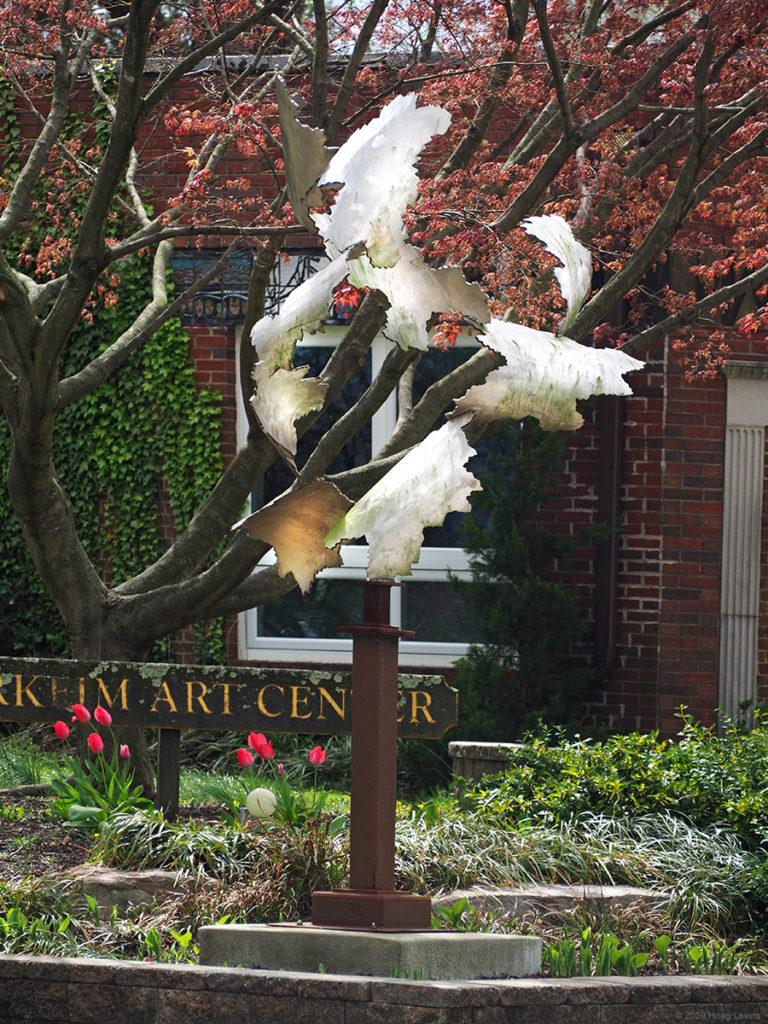 A tree-like sculpture by artist Joe Money that stands outside Haddonfield's Markeim Art Center
