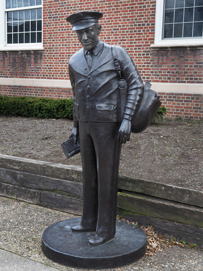 "The sculpture ""The Mailman"" by Thomas Bichko in Haddonfield, NJ"