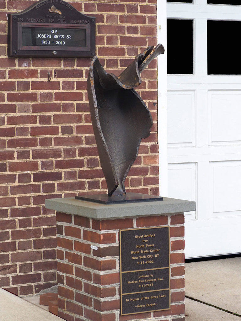 A 911 memorial stands in front of Haddonfield Fire Company No. 1