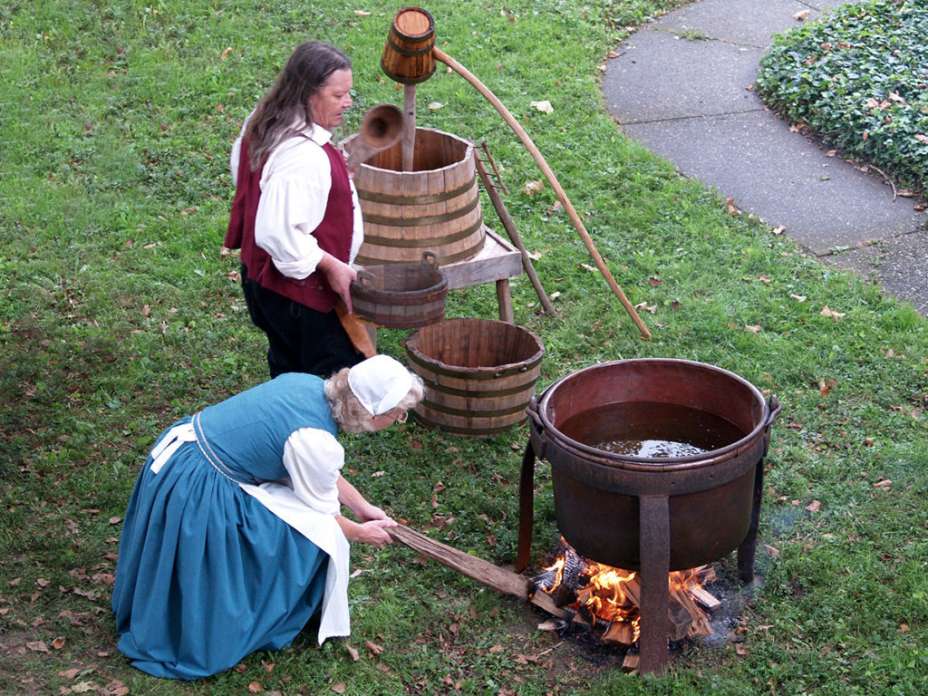 Beer historians Richard and Ann Wagner demonstrating Colonial beer making