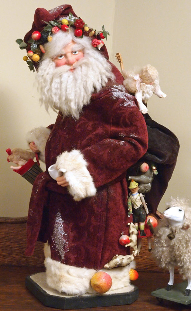 Yvonne Carpenter's custom-made Father Santa with a sack spilling out toys