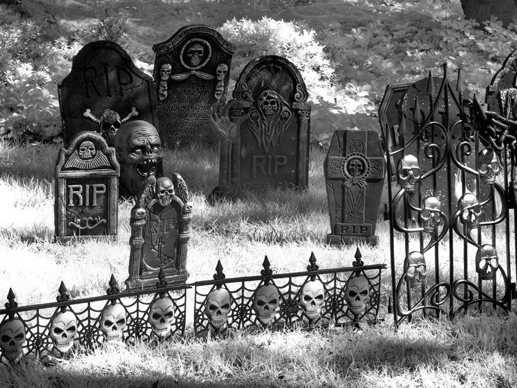 Faux graveyard scene on a Halloween lawn
