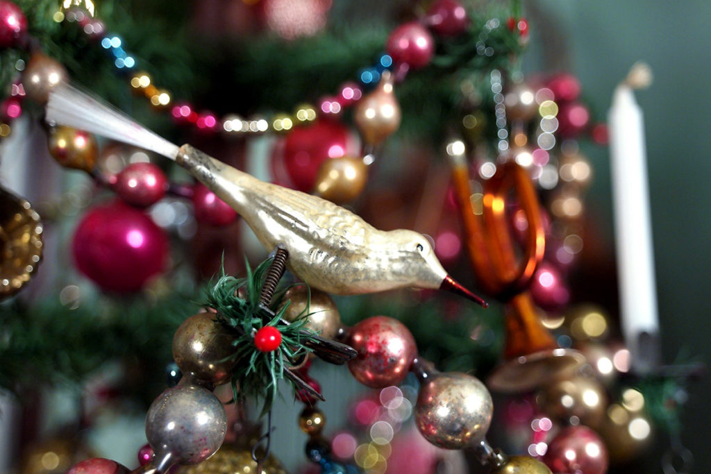 A 19th-century antique hand-blown German glass bird Christmas ornament.