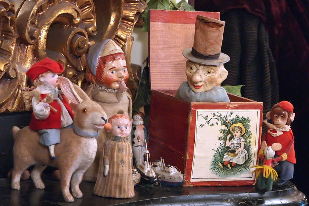 Victorian toys displayed as part of a decorative Christmas mantle display
