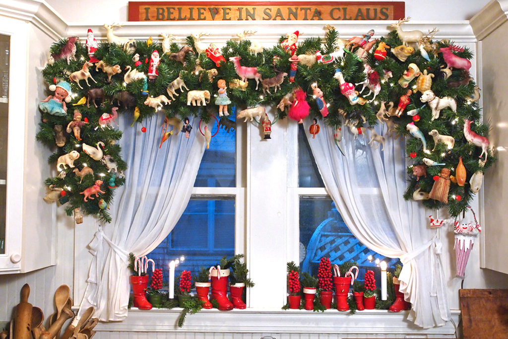 A large garland of antique celluloid Christmas toys