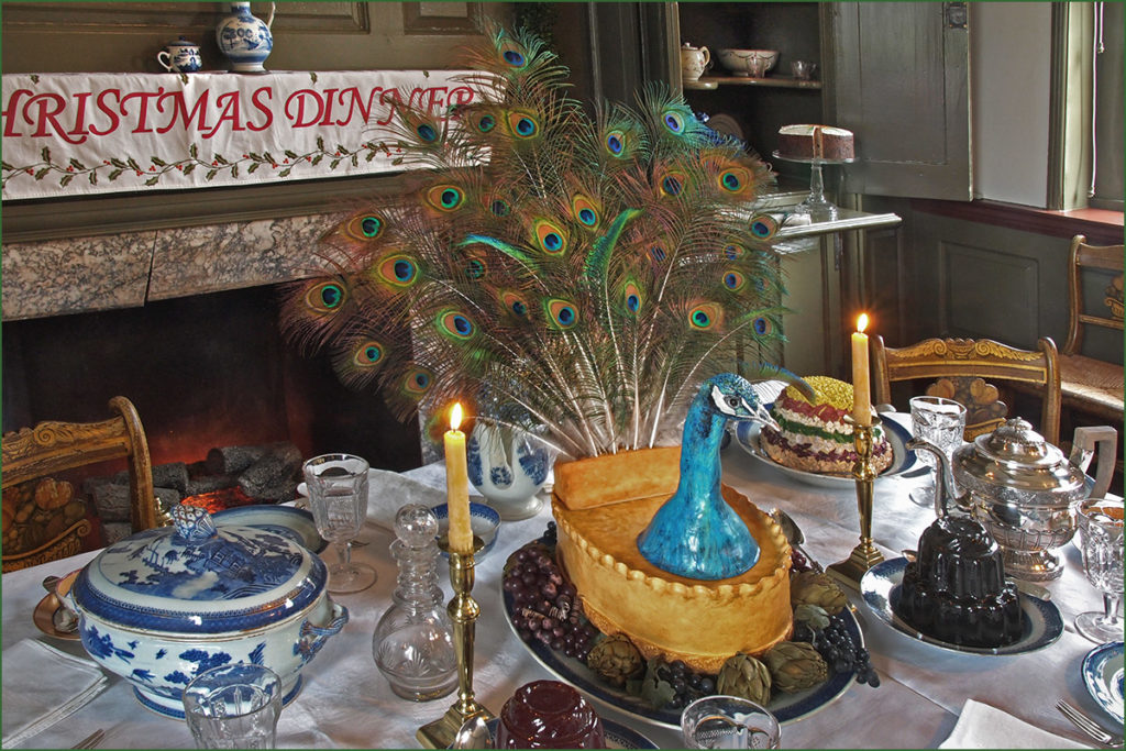 A peacock pie with full feathers dominated the main dining table at the Wilson-Warner mansion Christmas feast