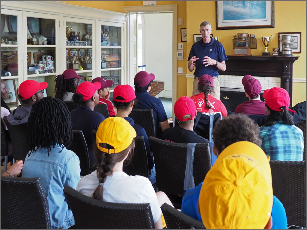 Rowing champion Dan Lyons of Team Concepts, Inc., instructs a new class of rowing students.