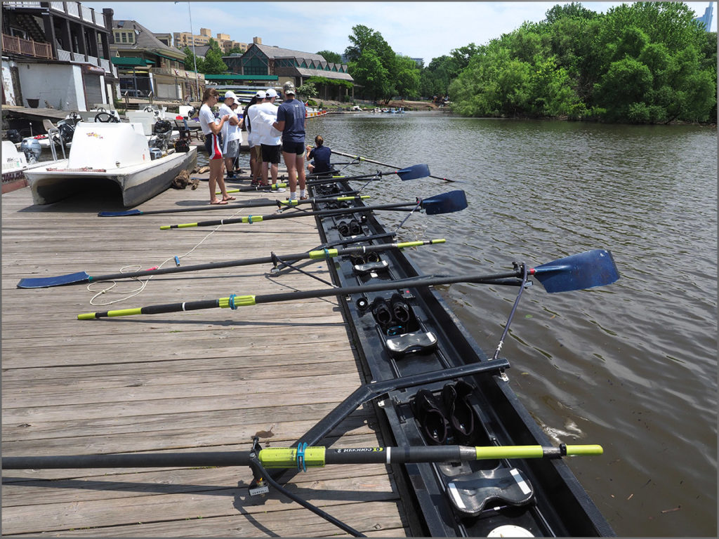 A nine-man racing shell moored at a boathouse dock in Philadelphia.