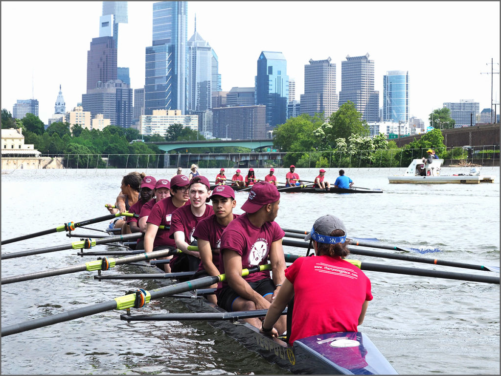 Shell racers on the Schuylkill River move out into the main river current.