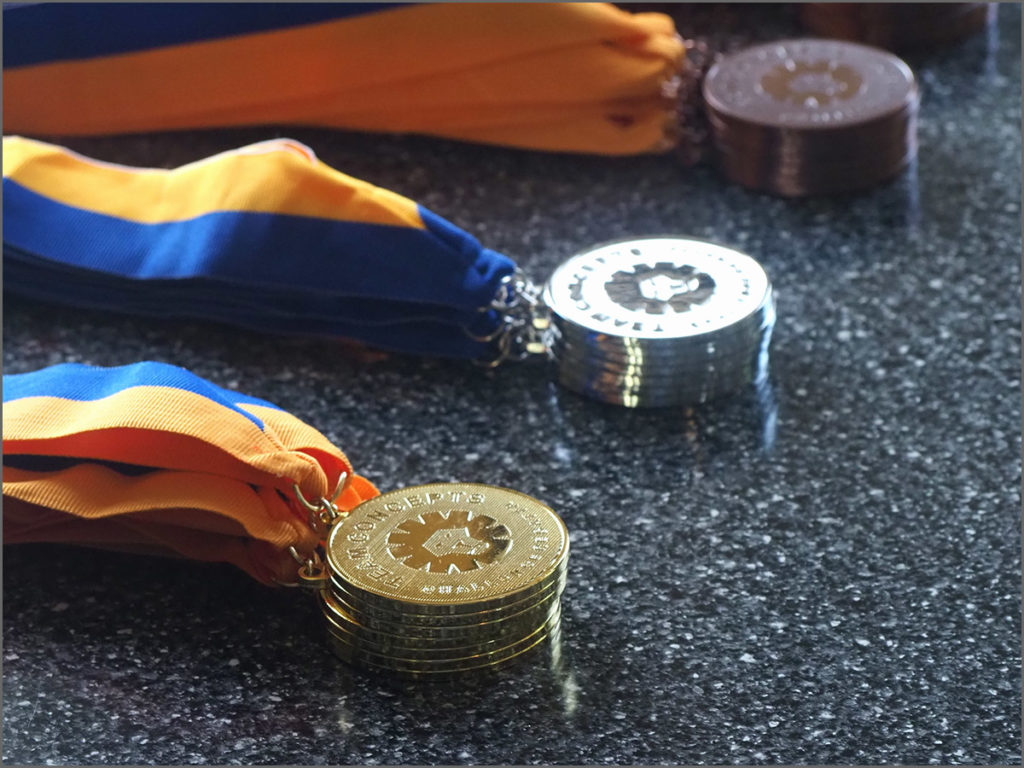 Gold, silver and bronze medals awarded in rowing races along Boathouse Row.