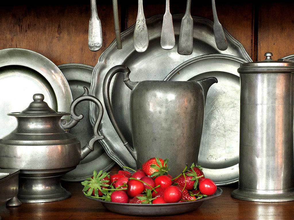 18th-century pewter pitcher, teapot and plates.