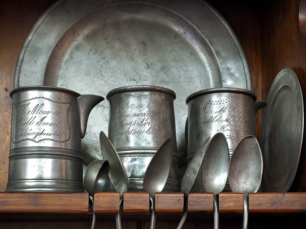 18th-century pewter pitcher, mugs and plates