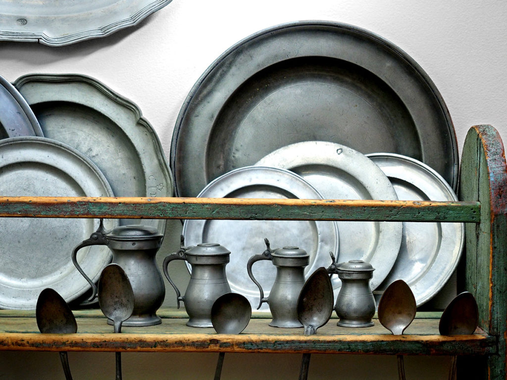 Pewter spoons, plates, tankards, and spoons