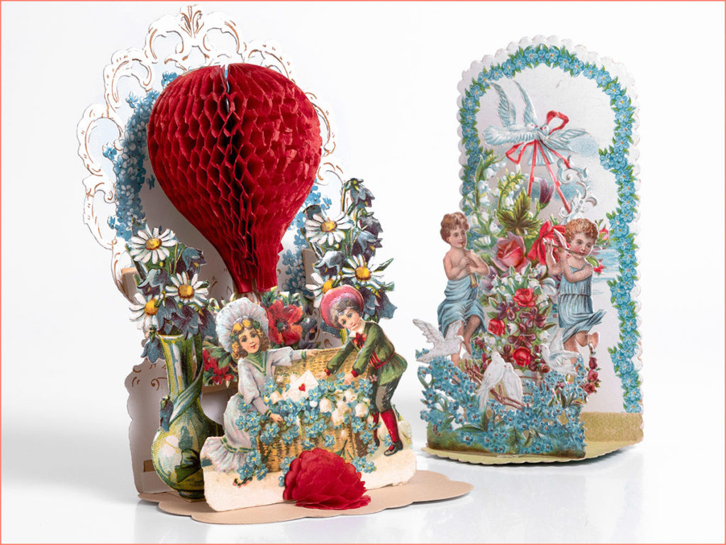 """Two 3D valentine cards, one with """"honeycomb"""" paper structure of a air baloon."""