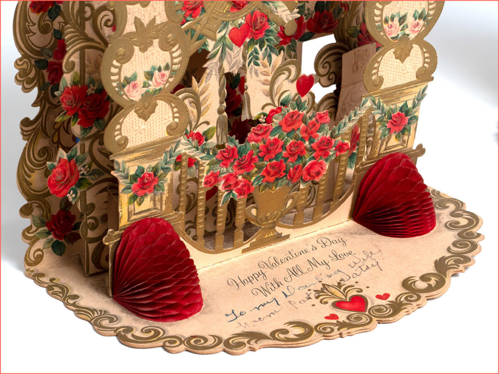Close-up of the bottom part of an ornate 3D card dating to 1913