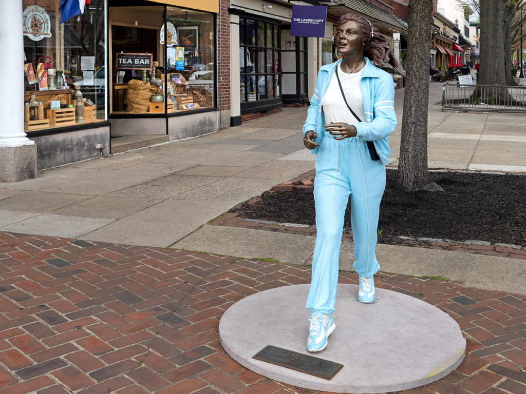 """1987 work of the late Seward Johnson, """"Shaping Up"""" is a life-size sculpture of a young women in workout garb situated in the center of Haddonfield's shopping district."""