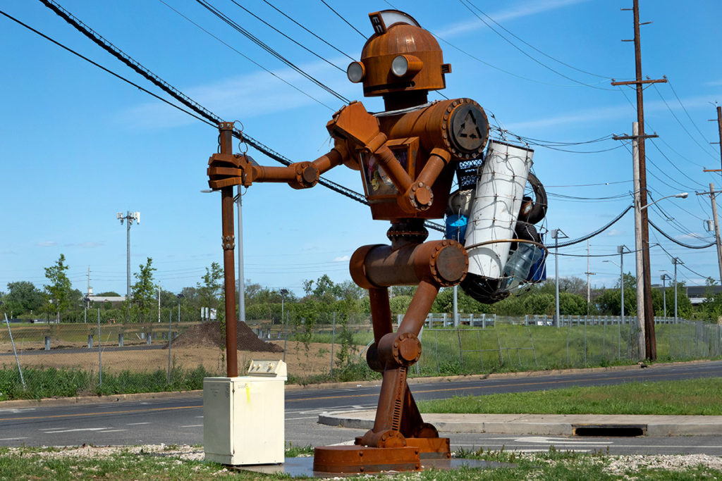 A 17-foot-high robot sculpture collects industrial trash as part of the New View-Camden program